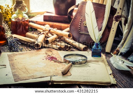 Old witcher labolatory full of scrolls and recipe - stock photo