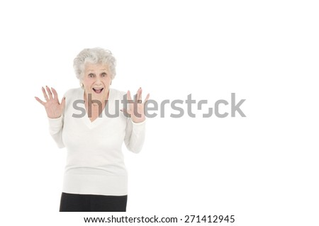 Old woman acting surprised against a white background