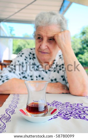 old woman and tea - stock photo