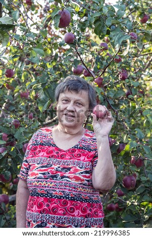 old woman at garden - stock photo