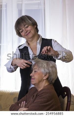 Old woman at the hairdresser - stock photo
