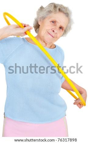 old woman doing gymnastic with hula-hoop - stock photo