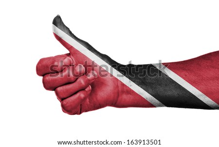 Old woman giving the thumbs up sign, isolated, flag of Trinidad and Tobago