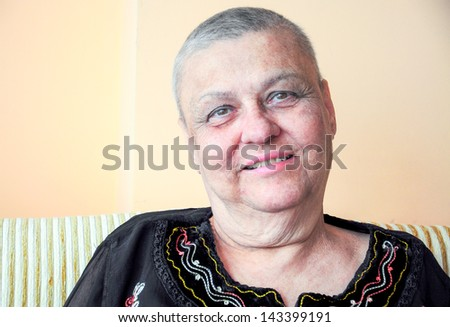 old woman has so short hair because of cancer therapy - stock photo