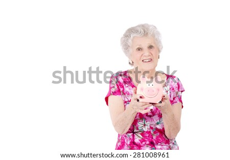 Old woman holding a piggy bank against a white background - stock photo