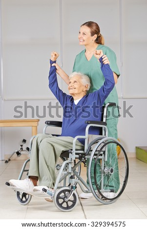 Old woman in wheelchair in physiotherapy in a nursing home