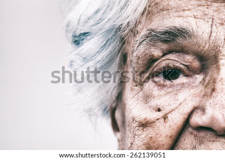 Old woman, intentionally toned image - stock photo