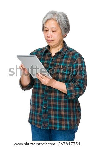 Old woman learn to use tablet - stock photo