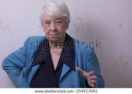 Old woman making a gesture - stock photo