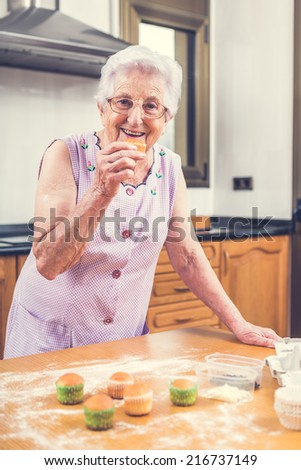Woman Decorating Cupcakes happy elderly woman eating lunch drinking stock photo 651383044