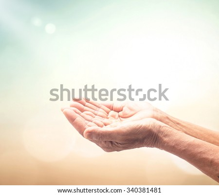 Old woman open empty hands with palms up, on blurred sunrise with amazing light background. Pray for support concept. Business, Environment Day, World Mental Health Day, Dignity, thanksgiving concept. - stock photo
