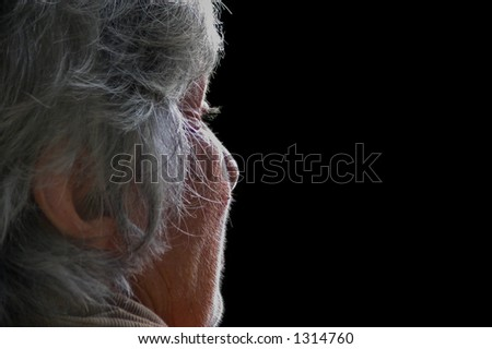 old woman portrait with natural light making her face glow with divine light and intensity - stock photo