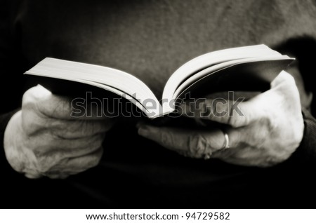 old woman reading the bible