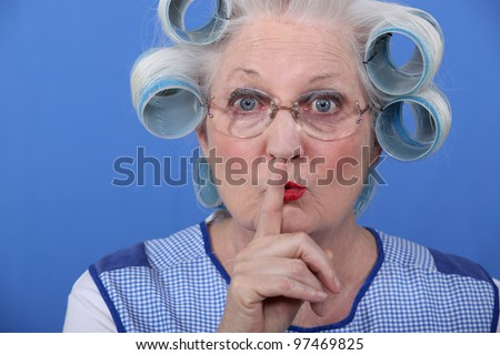 Old woman requesting to be quiet