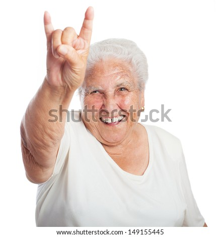old woman rock gesture on white background - stock photo