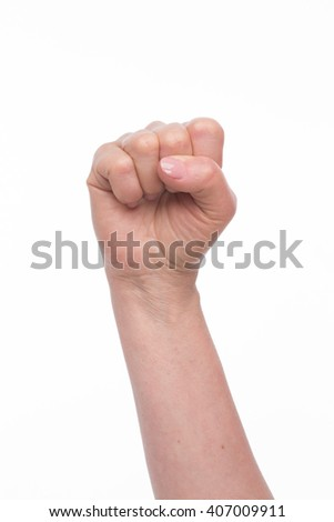 Old woman's fist represented over white background. Nice fist showing courage, power, success in company, firm or enterprise.