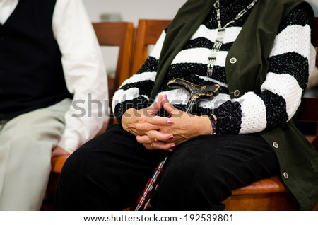 old woman's hands joined together  - stock photo