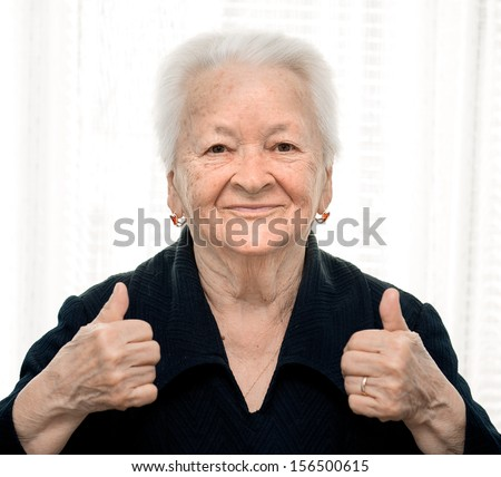 Old woman showing ok sign  - stock photo