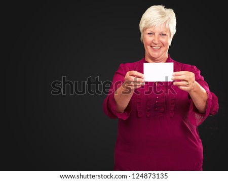 Old Woman Showing  Paper On Black Background - stock photo