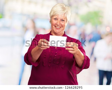 Old Woman Showing  Paper, Outdoor - stock photo