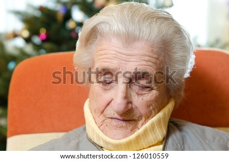 Old woman sleeping - stock photo