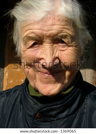Old woman smiling - stock photo