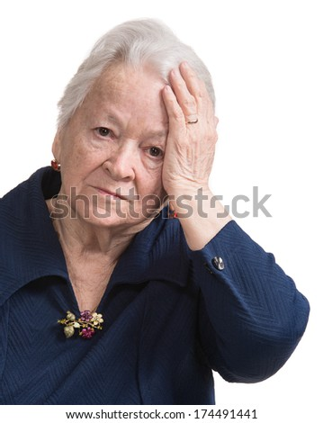 Old woman suffering from headache on a white background