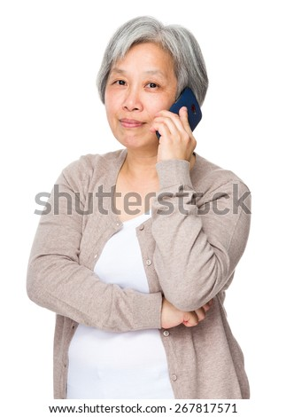 Old woman talk to mobile phone
