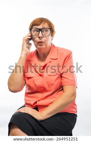old woman talking on a cell phone - stock photo