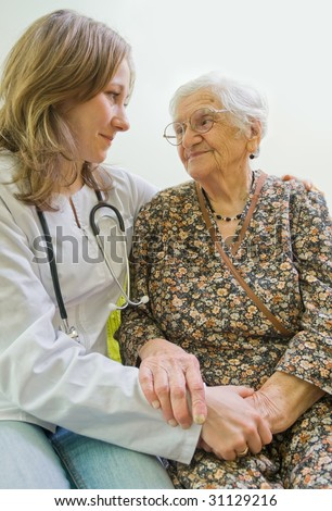 Old woman tells a story to the young doctor - stock photo