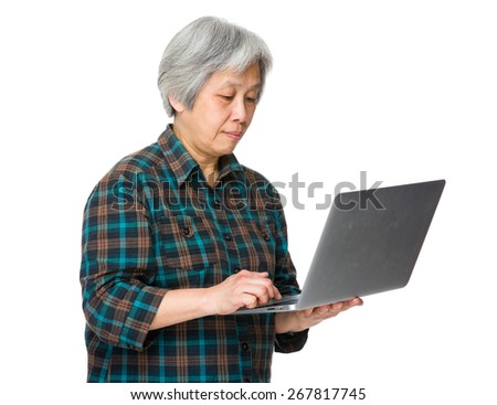 Old woman use of laptop