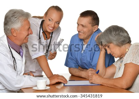 Old woman visitting  doctors  on white background - stock photo