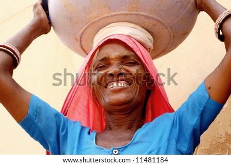 Old woman wearing a beautifully sari - stock photo