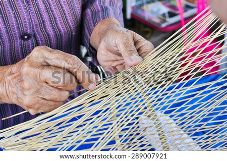 old woman weaving bamboo , Weave pattern hand bamboo,  - stock photo