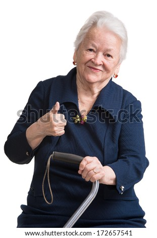 Old woman with a cane on a whitebackground - stock photo