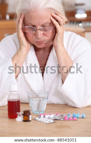 Old woman with a lot of medicine  to take - stock photo