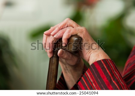 Old woman with a stick - stock photo