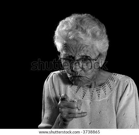 Old Woman With Glasses Wagging Her Finger in Anger