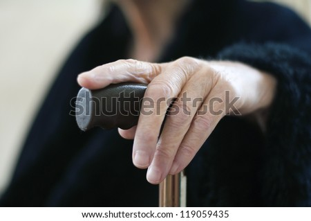 old woman with stick - stock photo