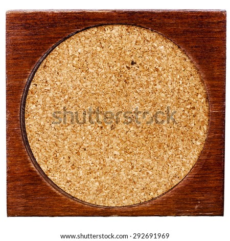Old wood and cork table coaster isolated on white background