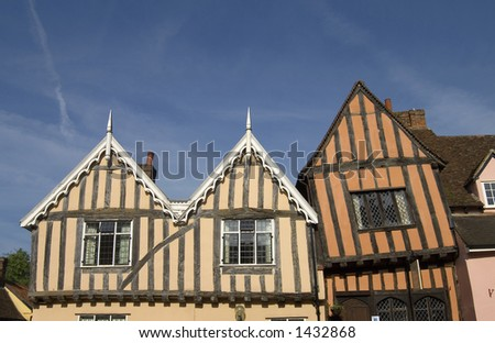 Old wood and plaster buildings typical of the ancient historic village of Lavenham, Suffolk, England. - stock photo
