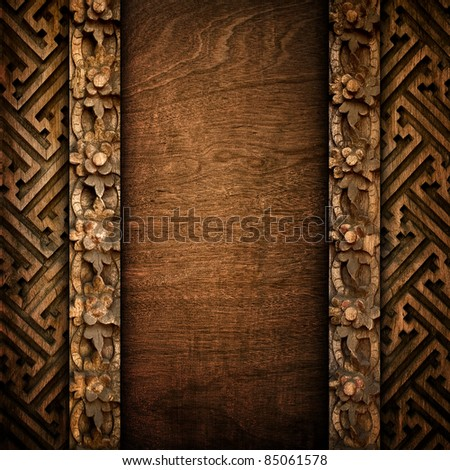 old wood background with carving - stock photo