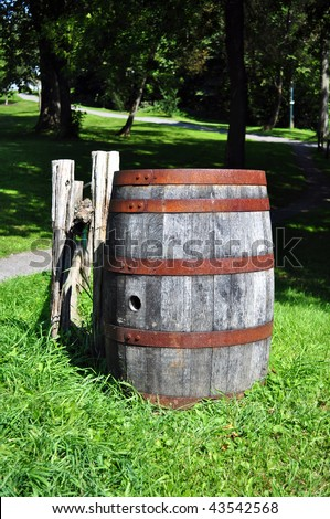 Old wood barrel abandoned in rural area