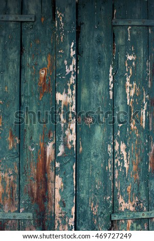 Old wood blue door background.