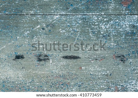 Old wood board cracked peeling green paint. - stock photo