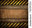 old wood board with warning stripe pattern - stock photo