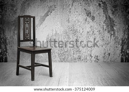 Old wood chairs, wood floors, white walls, concrete surfaces.