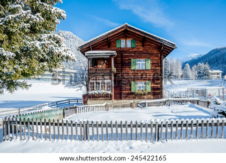 Old wood chalet in Davos, Switzerland on sunny winter day. - stock photo