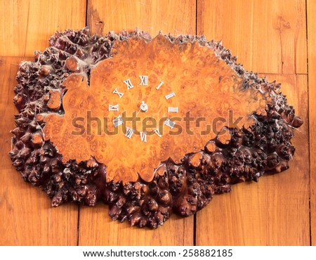 old wood clock on wooden board background - stock photo