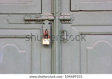 Old wood door and lock - stock photo
